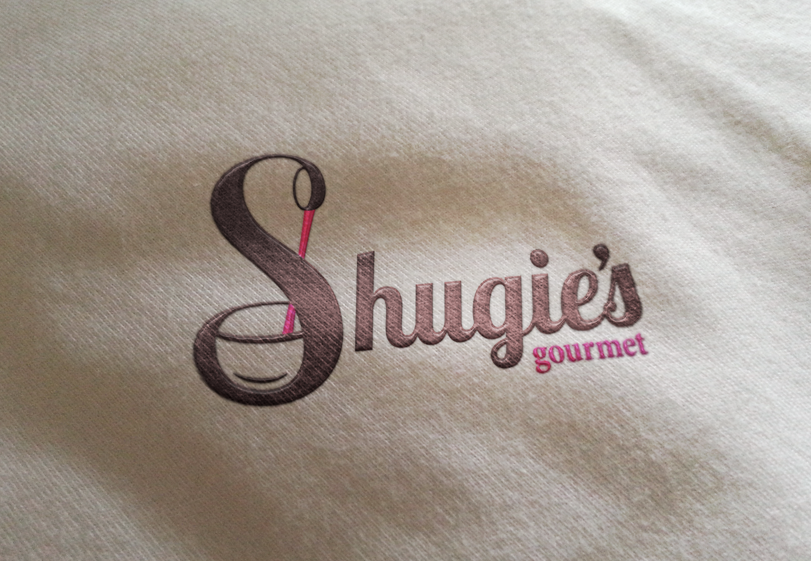 Shugie's logo on apron.